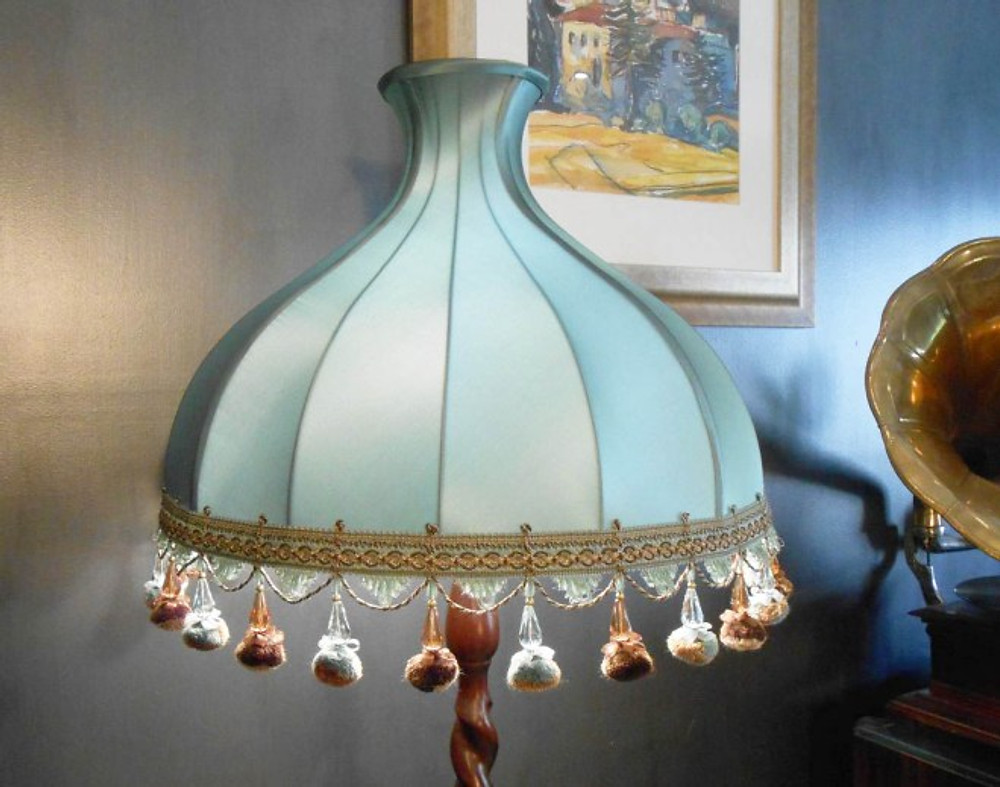 Handmade, soft lampshade in blue fabric with coloured tassle trim