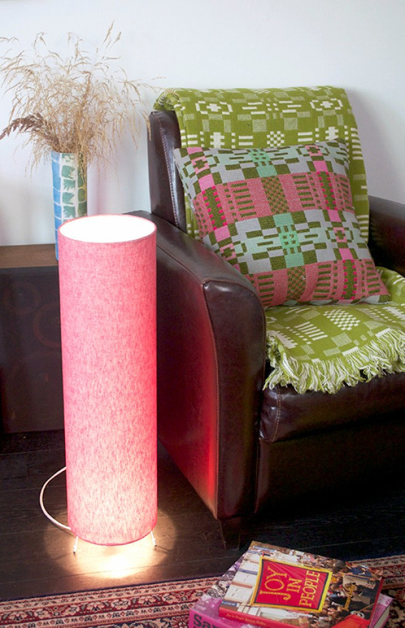 Floor lamp covered in red fabric