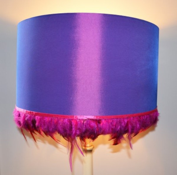 Drum lampshade with deep purple fabric and feather trim
