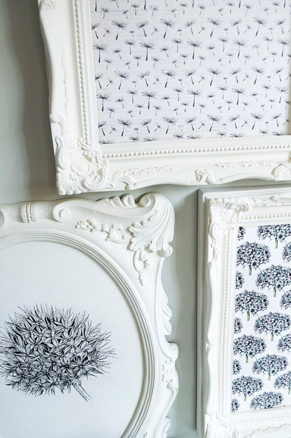 white picture frames on wall