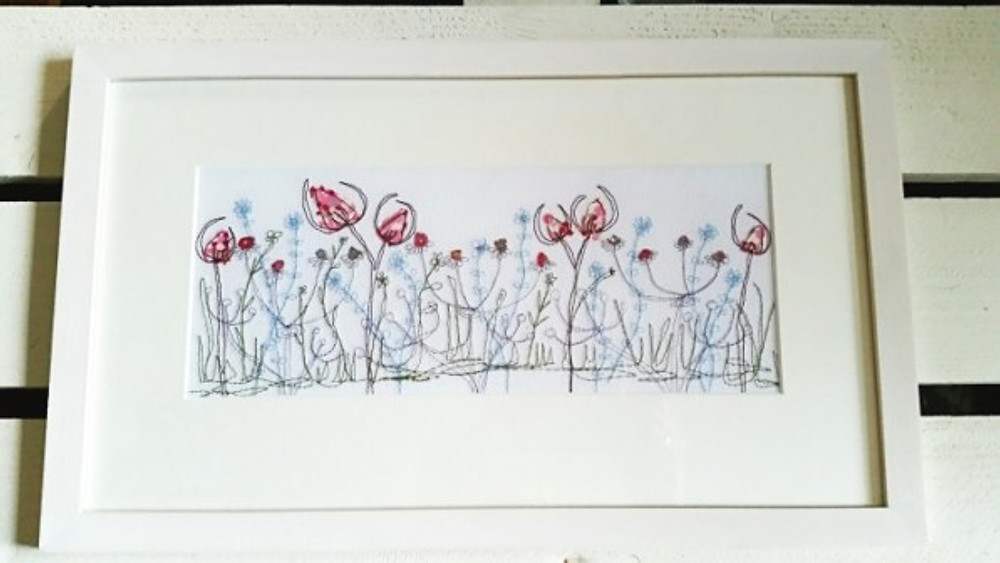 embroidery of flowers in a picture frame