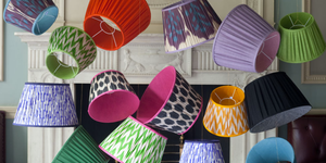 Handmade, colourful lampshades hanging from ceiling