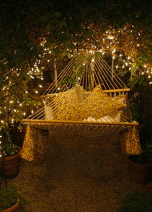 Fairy lights around an outdoor hammock