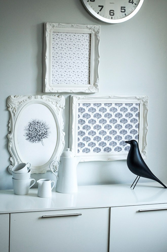 black-and-white picture frames with white crockery