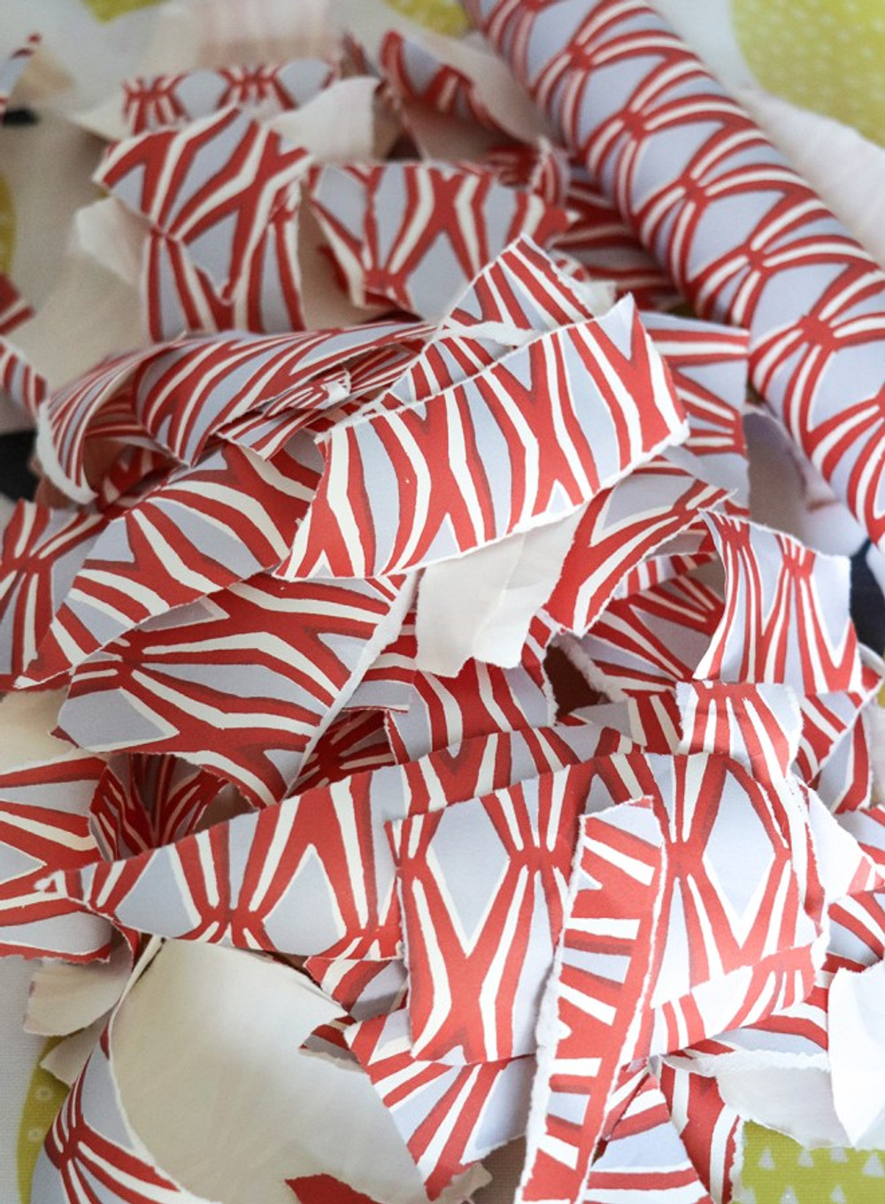 Colourful wrapping paper strips for making a handmade picture frame pin-board