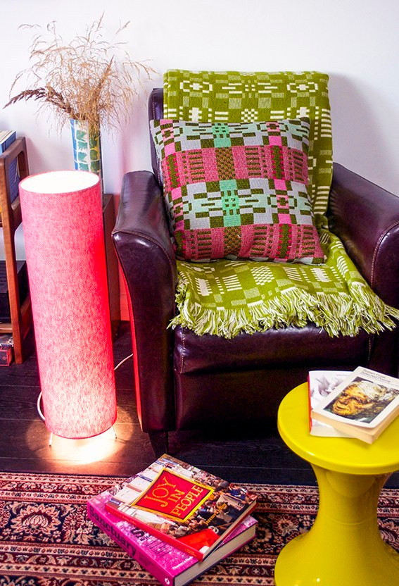 Floor lamp next to cosy armchair