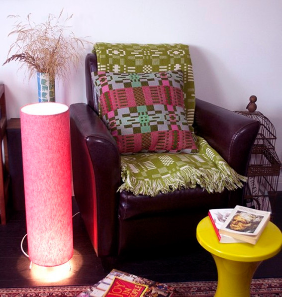 reading chair with lamp and books