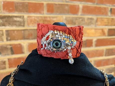 curious mondo red bracelet.jpg