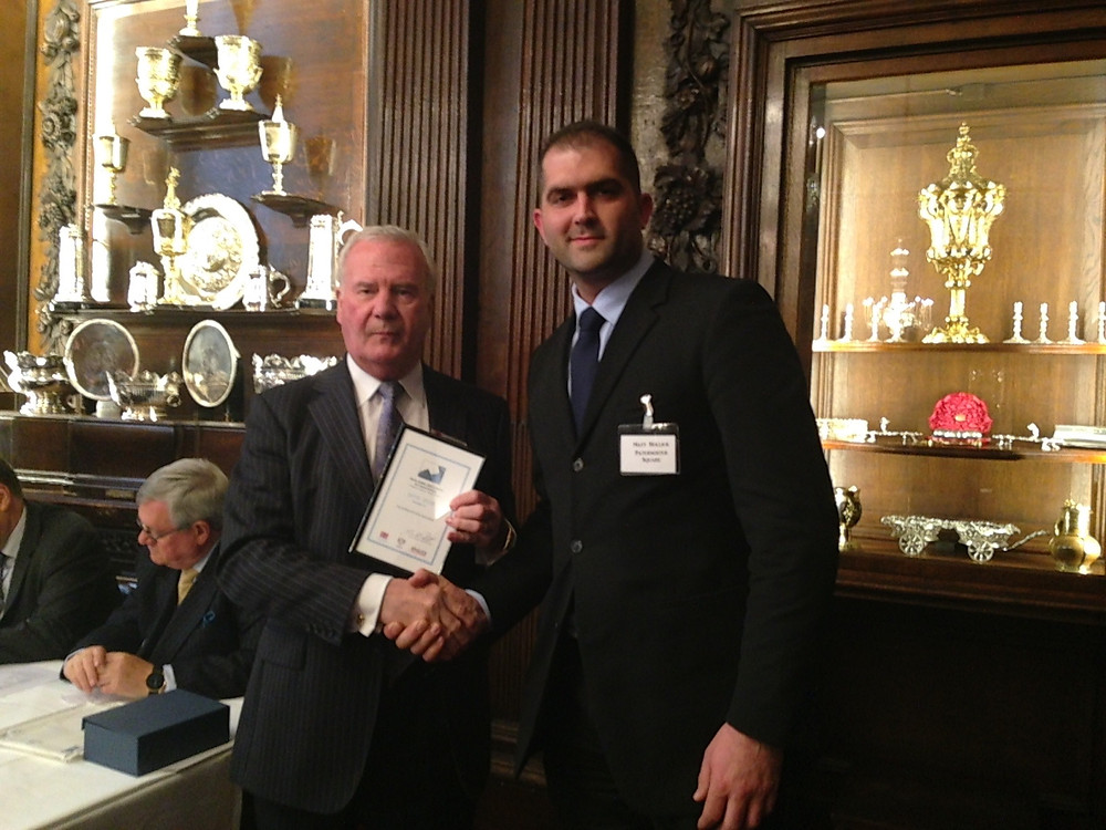Matthew Hollick, Axis Security Manager, being presented with the Business Security Accreditation