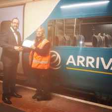 Cleaner and supervisor awarded for helping a train passenger