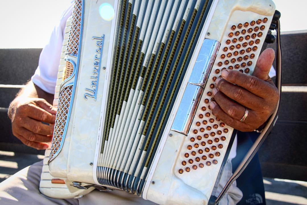 Musician playing the accordion on the Newport Beach pier