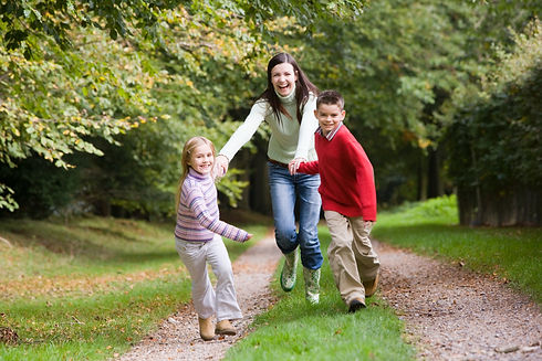 mother-and-children-running-along-woodla