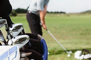 golfer-lines-up-at-driving-range.jpg