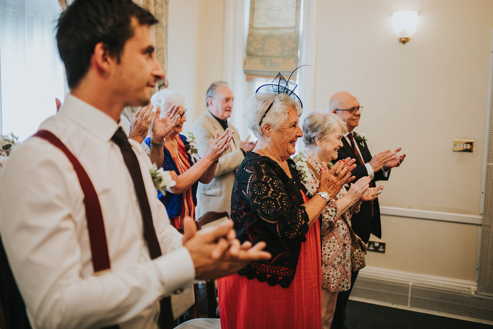 guests applauding the couple after the ceremony