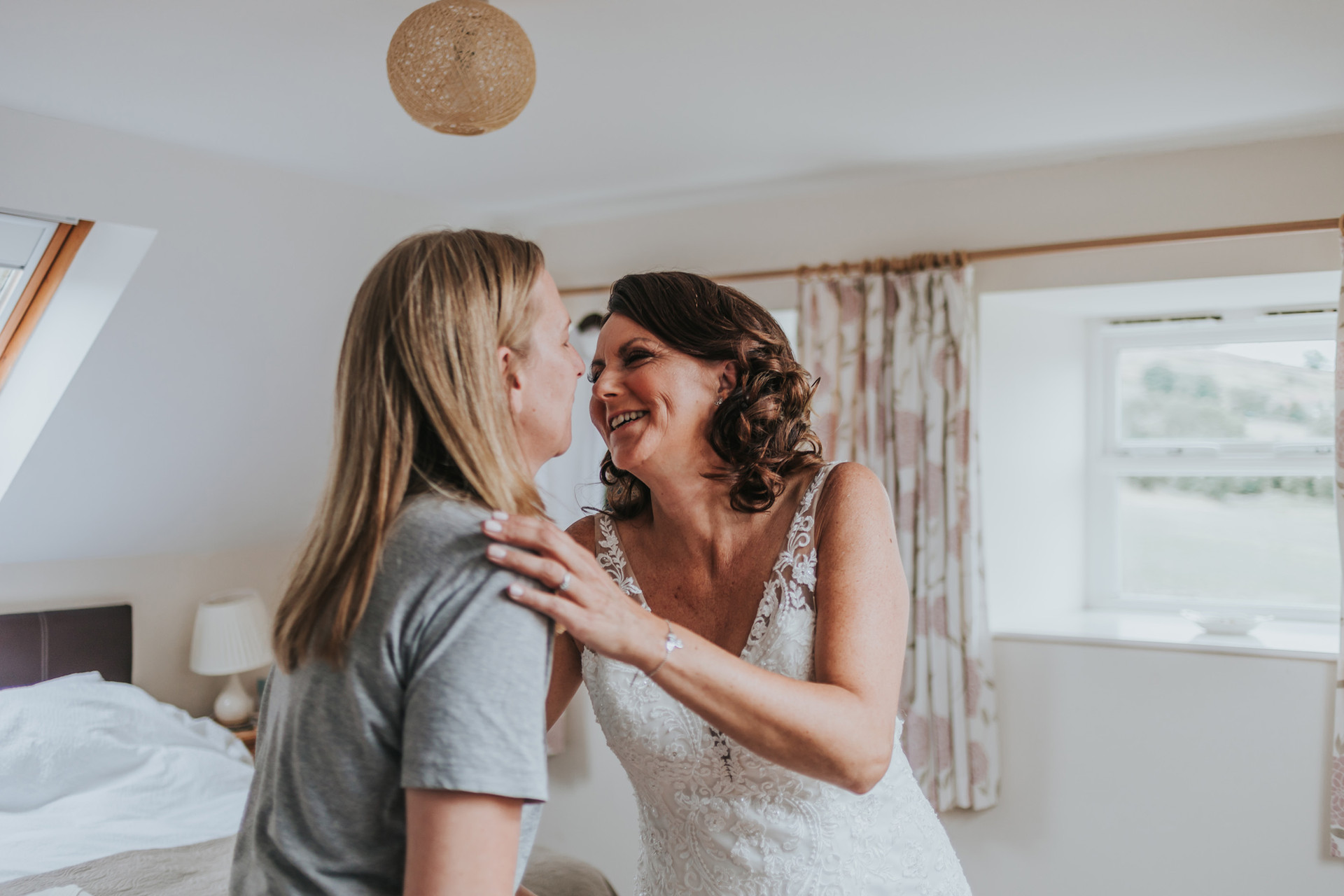 two brides getting ready for the wedding together at a cottage in whitby