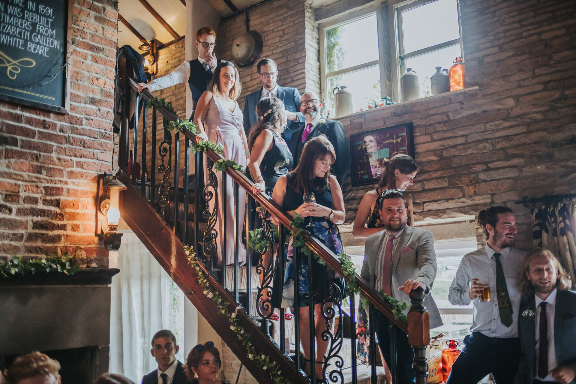 Guests lining the stairs at the back of the ceremony room