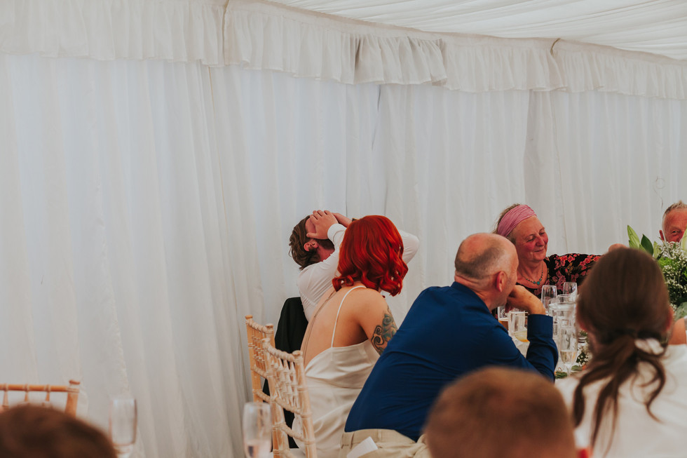 groom covering his face during the best mans speech