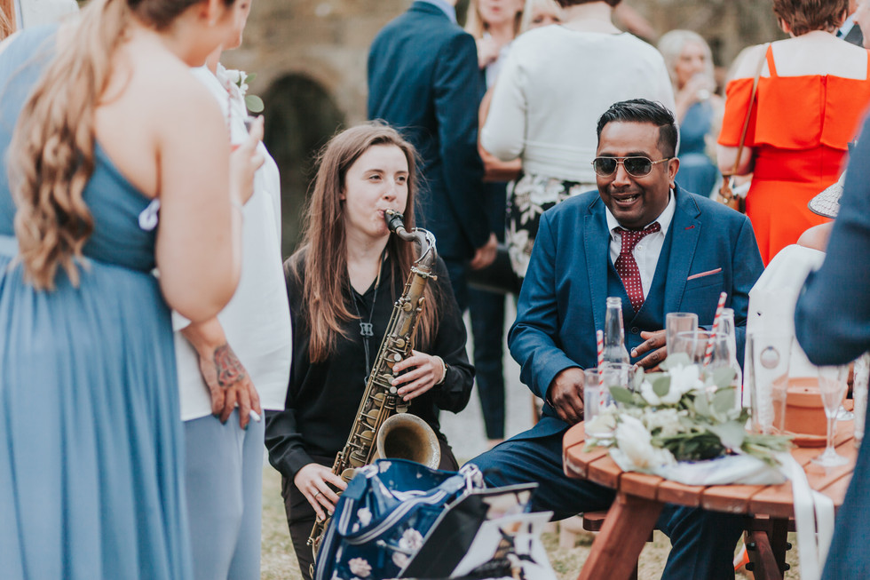wedding saxaphone player entertaining guests at danby Castle