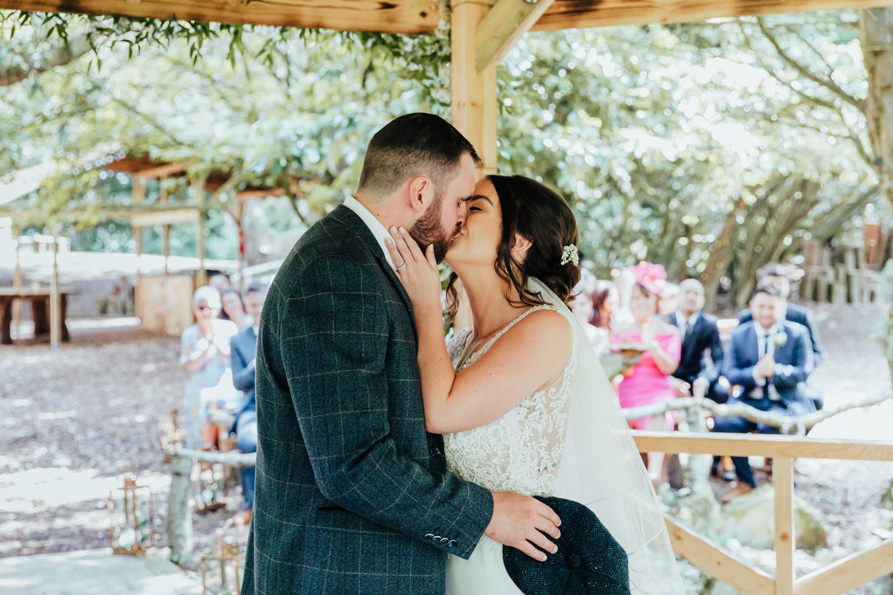ceremony outdoors at hazlewood castle woodland wedding venue