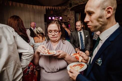 Bridesmaid eating pizza at Blossom Barn