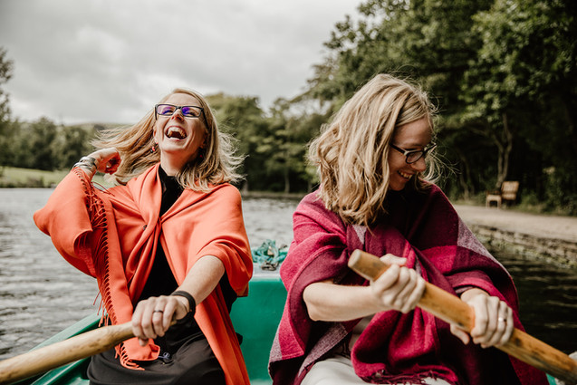 Two brides boating on the lake at Shibden Hall