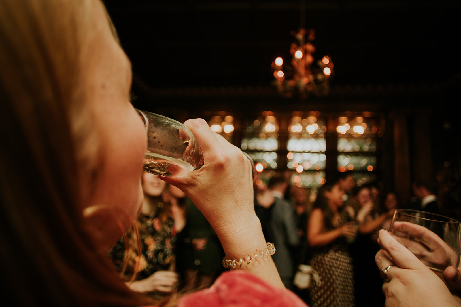 a woman drinking champagne