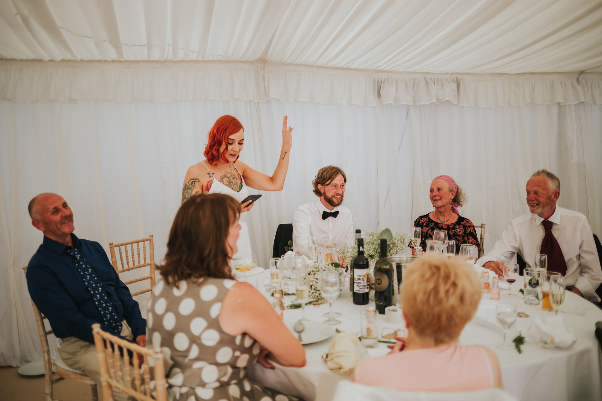 red haired tattoed bride giving a wedding speech in the marquee in halifax