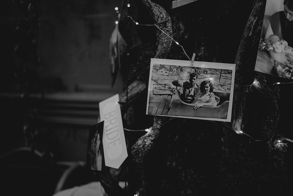 a vintage photograph on a tree surrounded by fairy lights at the lost and found leeds club