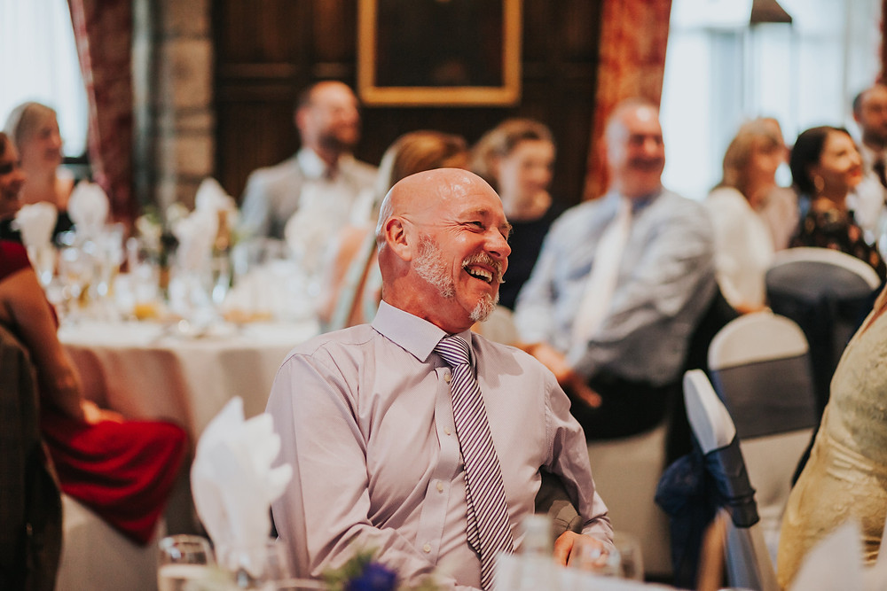guest laughing at the speeches
