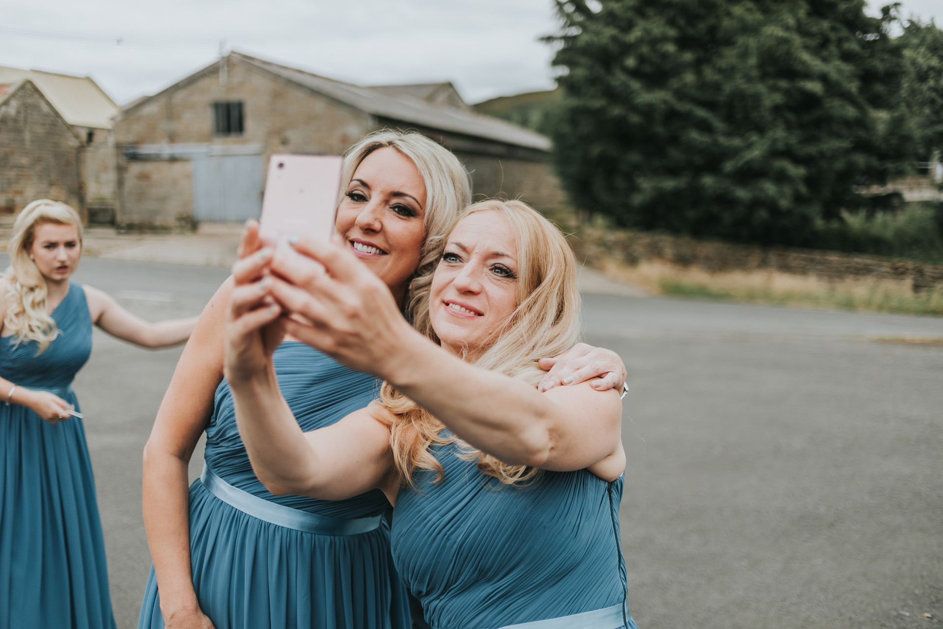 bridesmaid taking a selfie outside a cottage in whitby