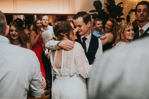 Couple having their first dance surrounded by friends at The Good Luck Club, Leeds