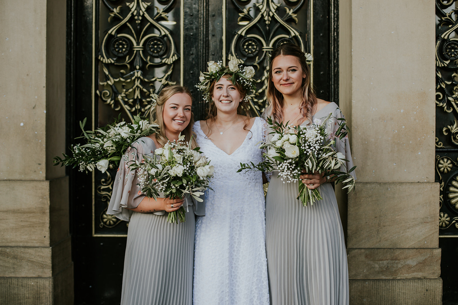 bride and bridesmaids outside leeds town hall