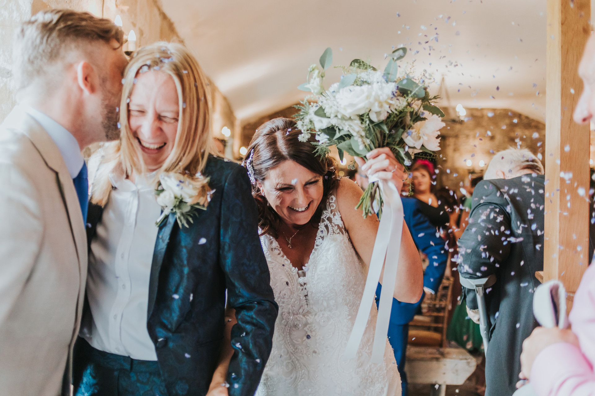 Guests throw confetti at Danby Castle
