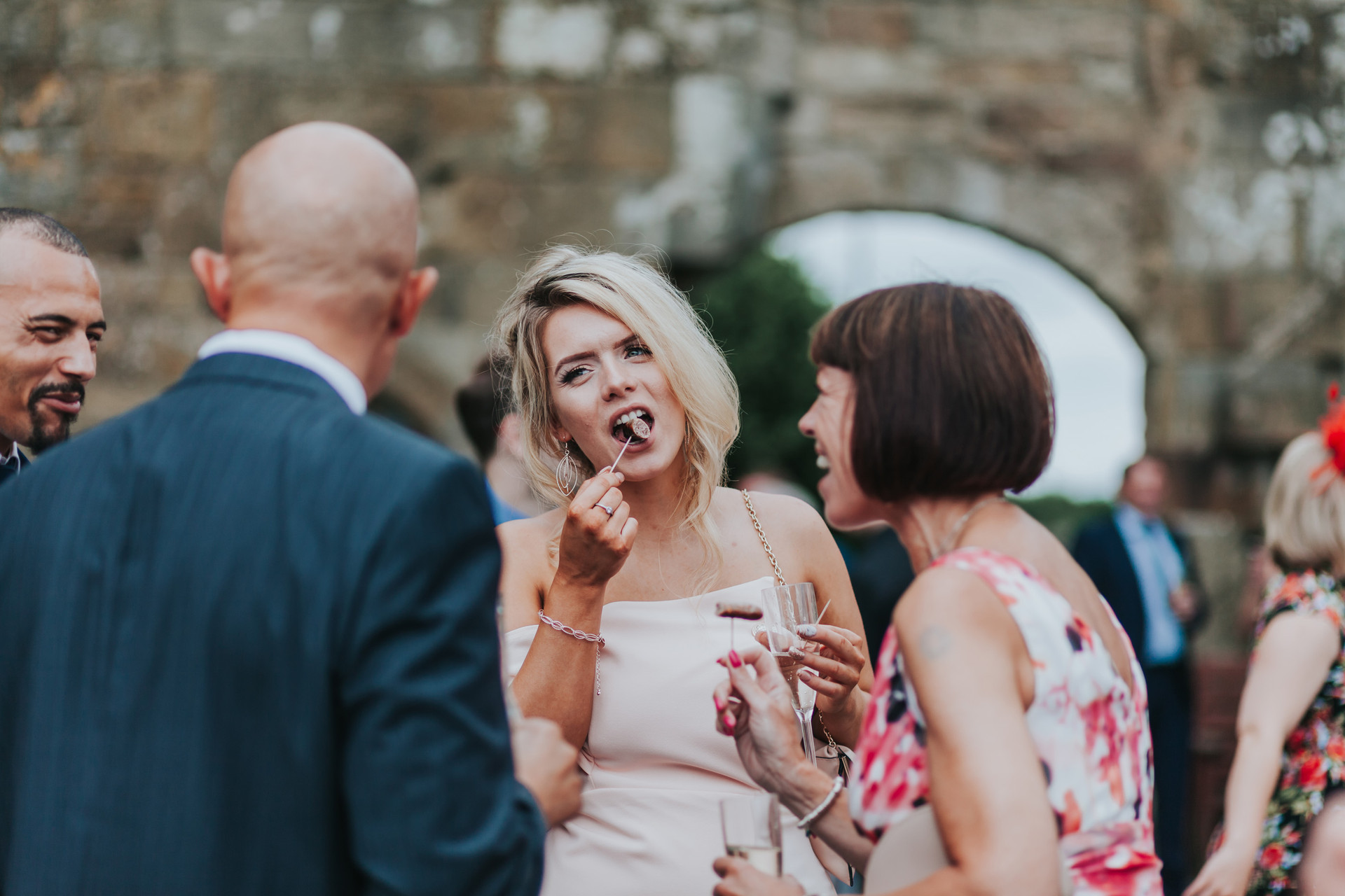 wedding guests having food outside Danby castle