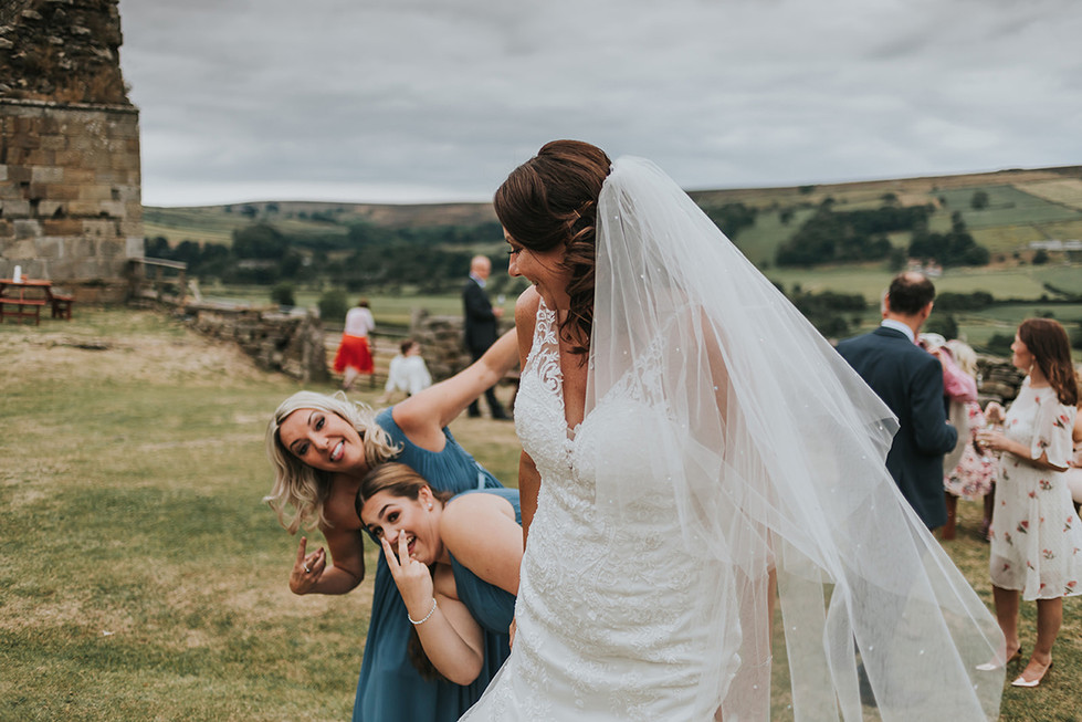 bride and bridesmaid outside at Danby Castle