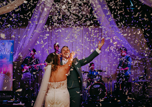 couple dancing after a confetti cannon at Rivington Hall Barn