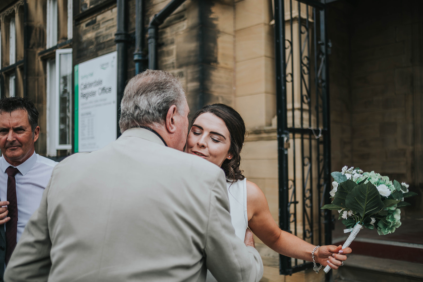 Bride greeting guests outside the registry office in halifax