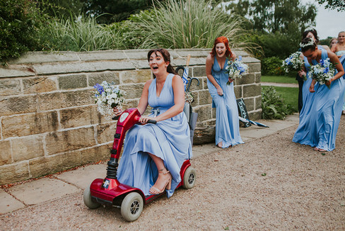 bridesmaid riding a scooter in Halifax