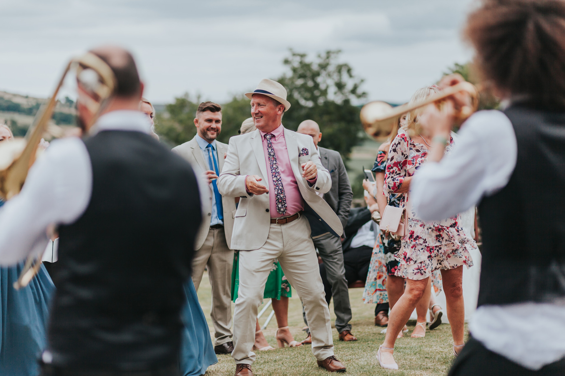 Wedding guests dancing outside at Danby Castle