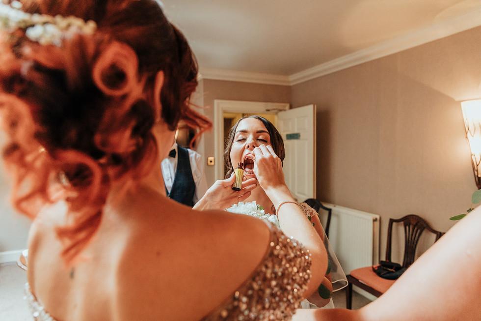 Bride taking rescue remedy at Hazlewood CAstle