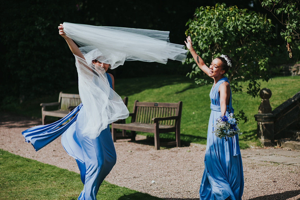 Bridesmaids in the gardens at Oakwell Hall