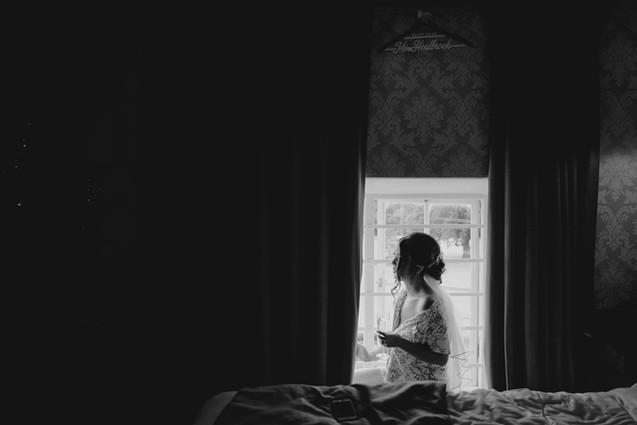 bride by the window at Hazlewood Castle