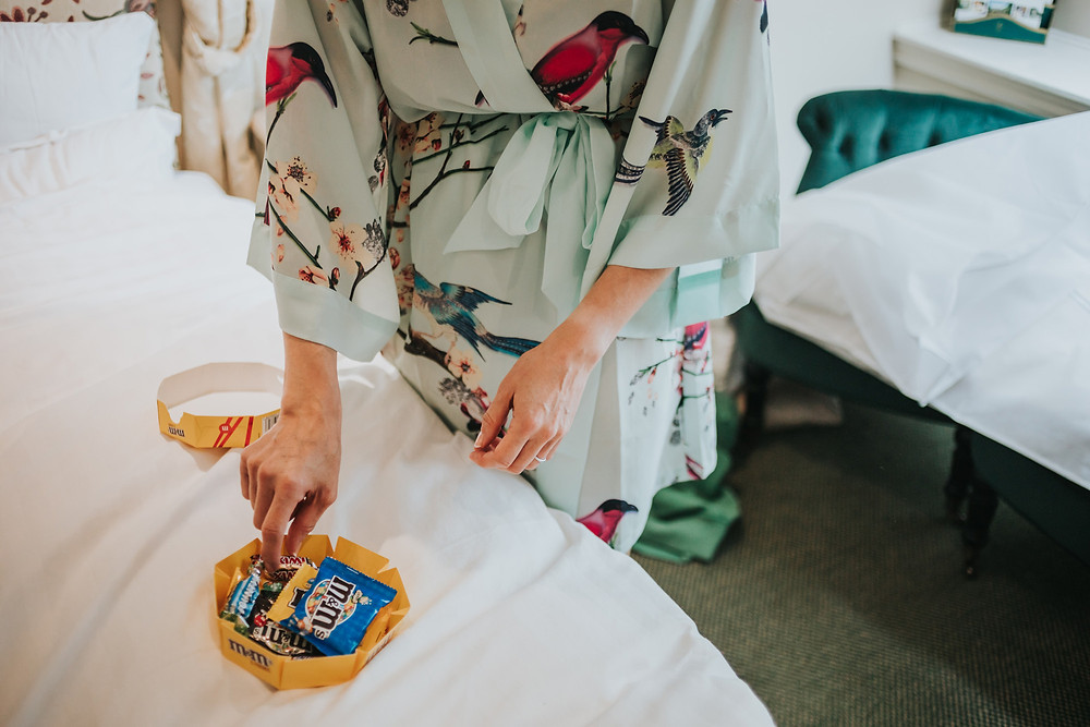 Bride eating sweets in her dressing gown before the wedding