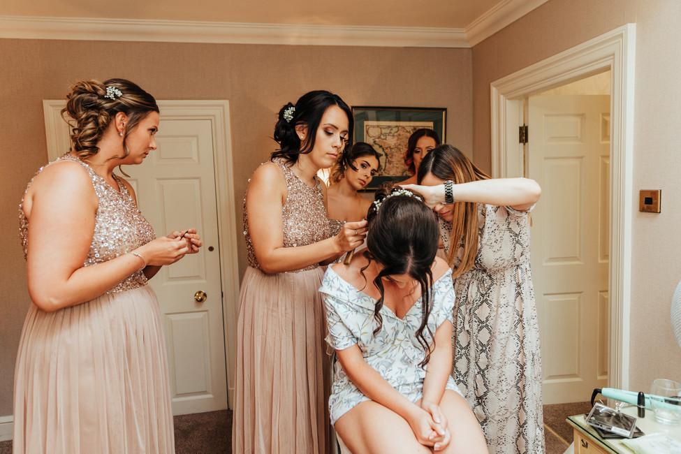 bridesmaids helping the bride at hazlewood castle
