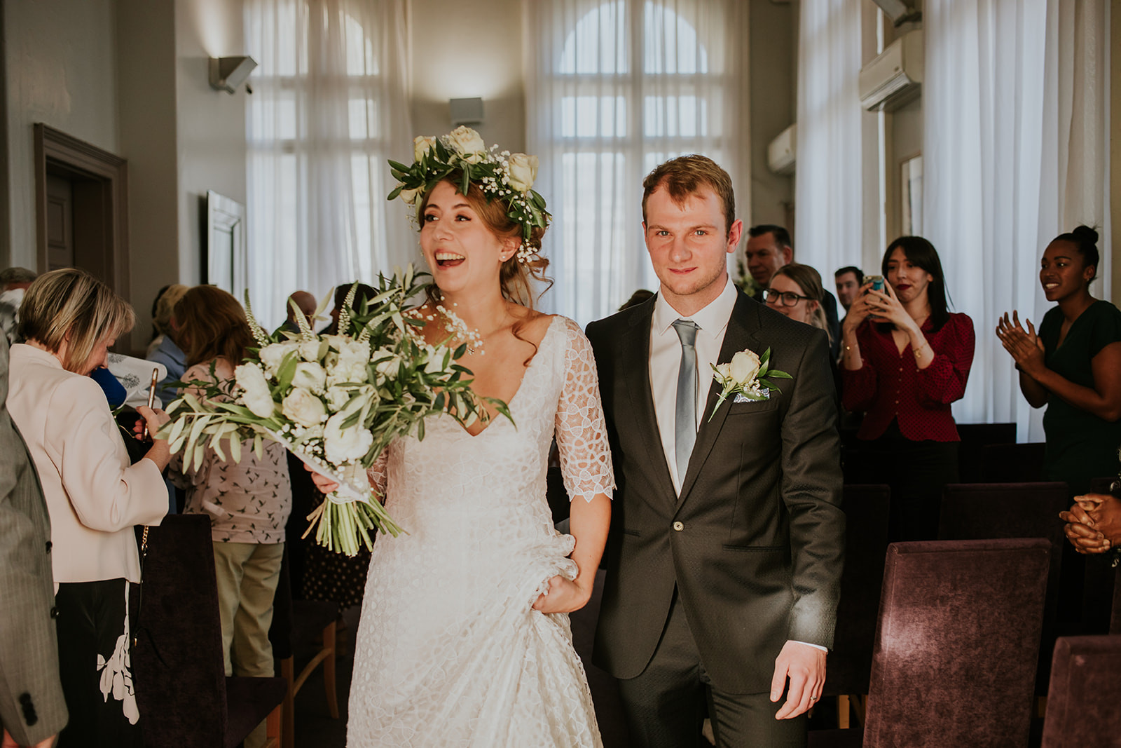 couple walking out of the ceremony room to the front of leeds town hall