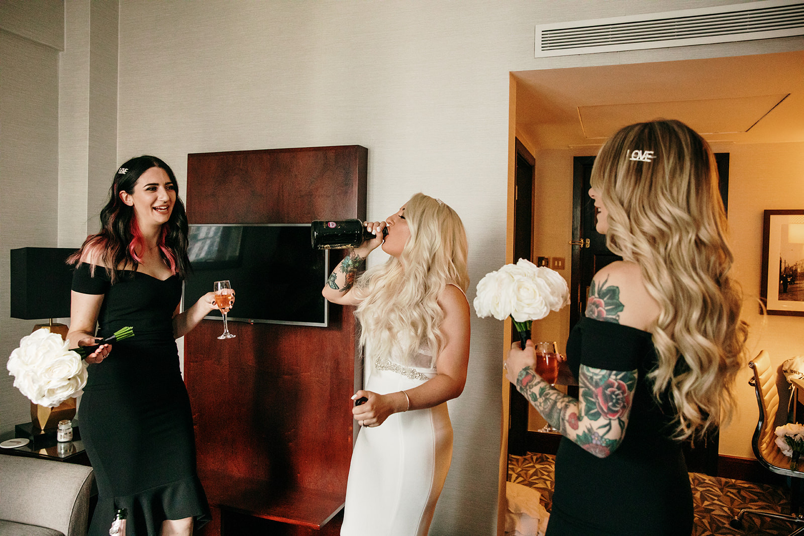 bride and bridesmaids having a drink before the wedding in manchester