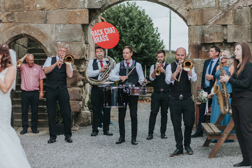 Brass band Back Chat Brass entertaining the wedding guests at Danby Castle