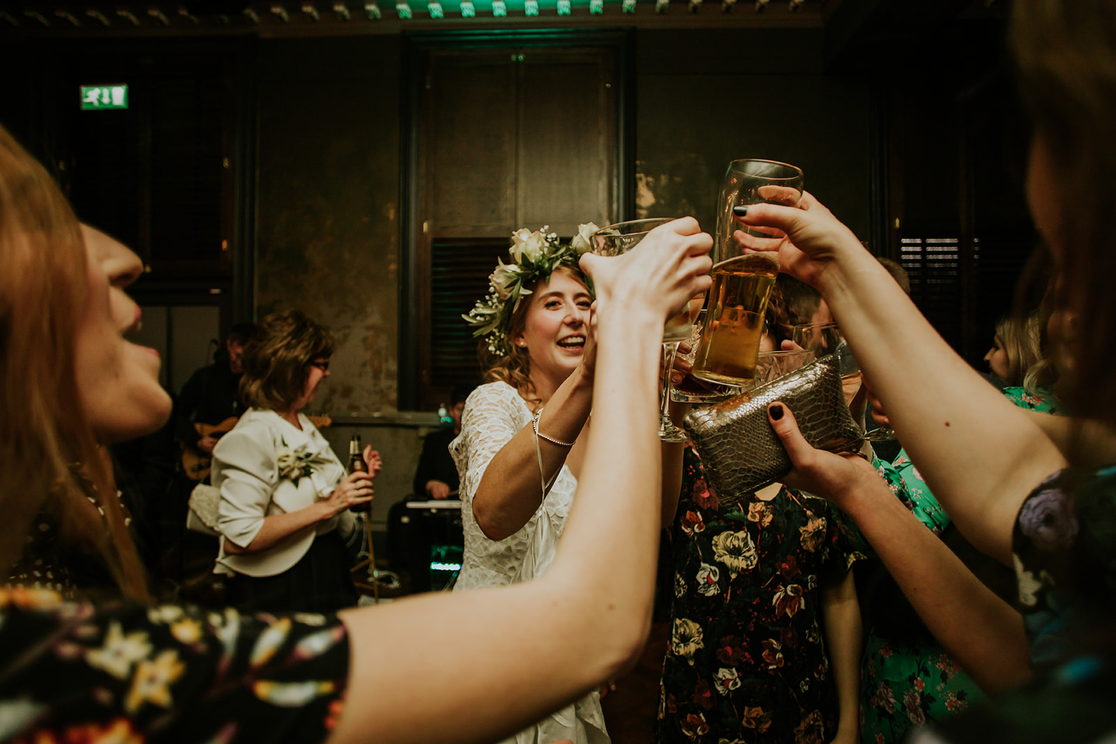 bride clinking glasses with her friends