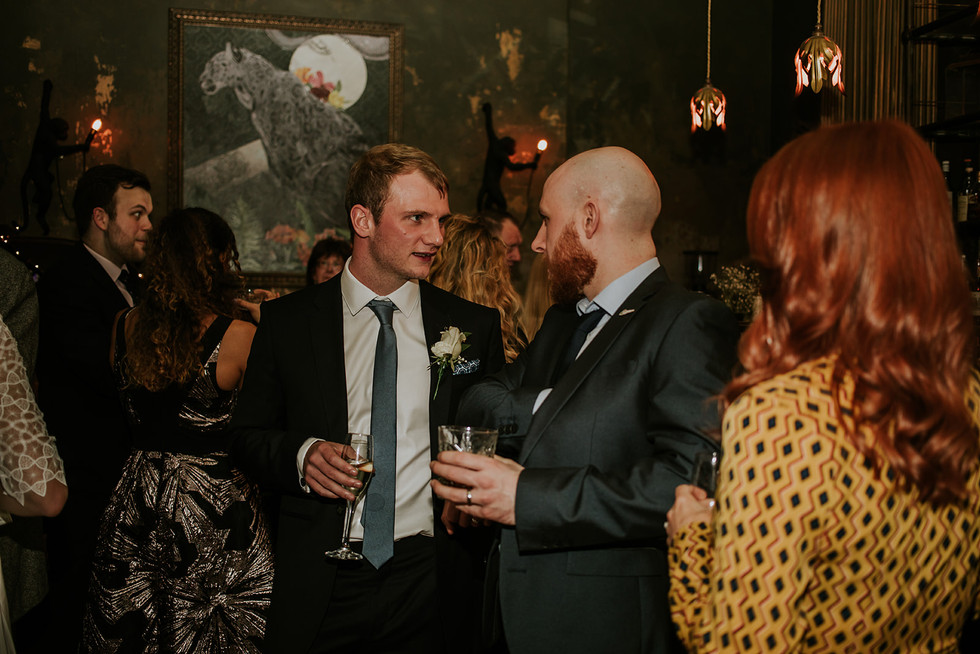 the groom chatting to guests