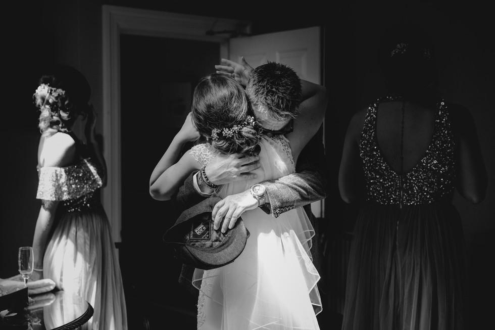 bride hugging her dad at hazlewood castle